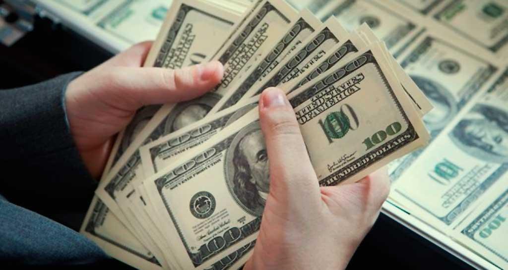 Moeda encerrou o ano cotada a R$ 3,94, uma valorização acumulada de 48,49%